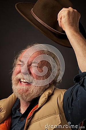 Free Senior Man Joyfully Waves Hat In Air Royalty Free Stock Images - 22133939