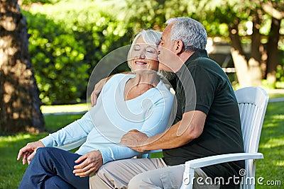 Senior man kissing woman in garden