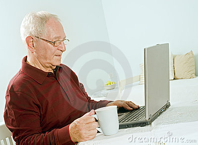 Senior man with laptop computer