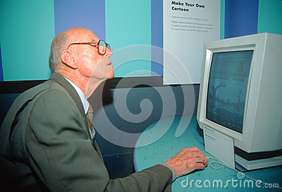 A senior man learning how to use a computer Editorial Photography