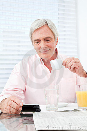 Senior man looking at smartphone
