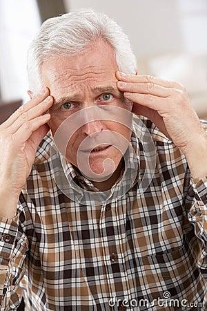 Senior Man Looking Stressed In Chair