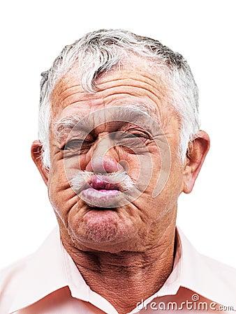 Senior man making crazy face on white background