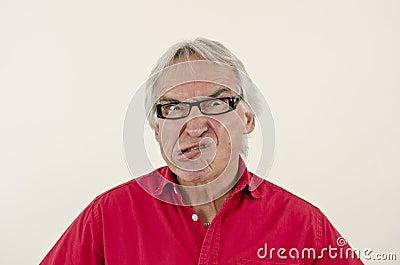 Senior man making an ulgy grimace