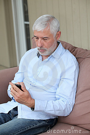 Senior man and mobilephone