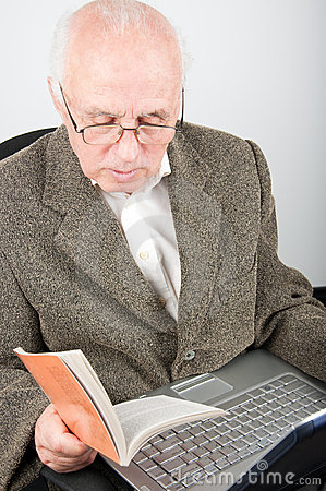 Senior man with notebook learning computer
