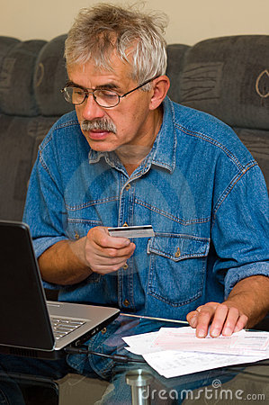 Senior man online shopping
