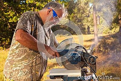 Senior Man Operating a Chop Saw