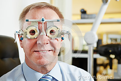 Senior man at optician with trial