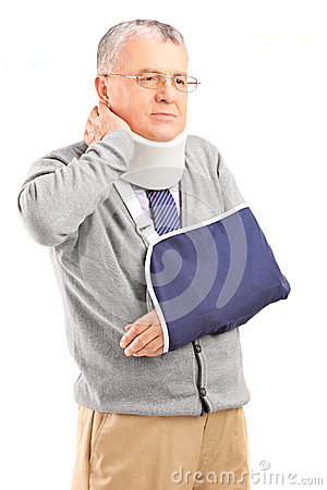 Senior man in pain wih a broken arm holding his neck