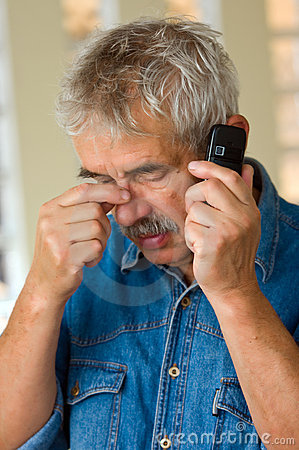 Senior man with phone