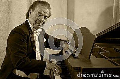Senior man pianist and singer