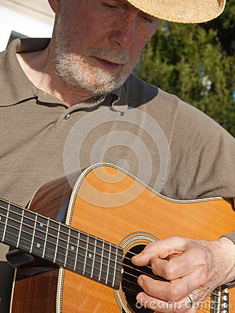 Senior man playing guitar