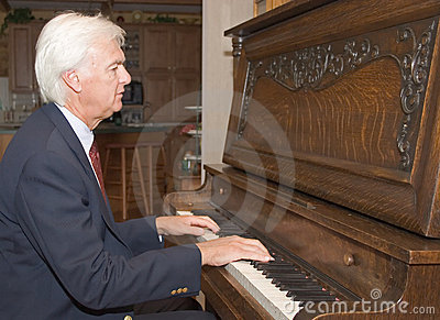 Senior Man Playing Piano