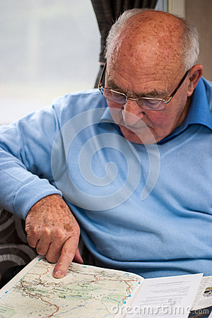 Senior man pointing on map location