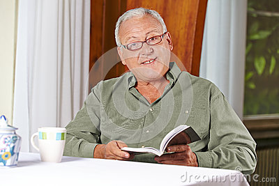 Senior man reading book in rest