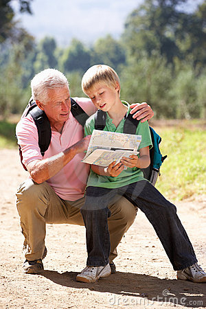 Senior man reading map with grandson