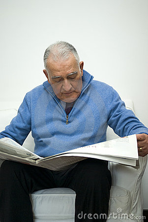 Senior man reading the newspaper