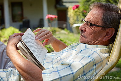 Senior man reading outdoor