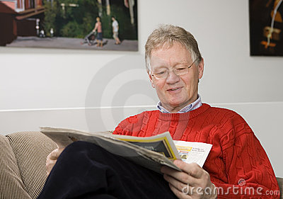 Senior man reading the papers