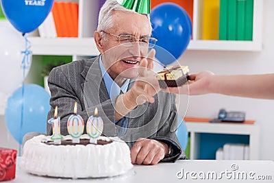 Senior man receiving birthday gift