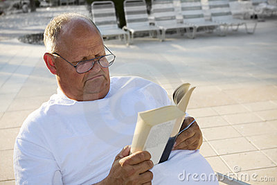 Senior Man Relaxing & Reading