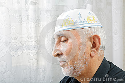 Senior man in religious hat
