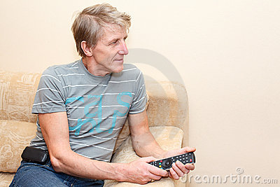Senior man with remote control and tv-set