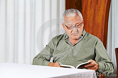 Senior man in rest home reading