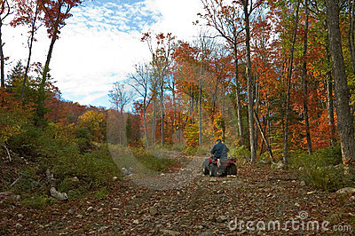 Senior  man riding an ATV quad