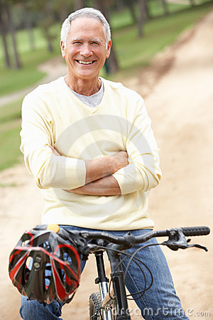 Senior man riding bicycle in park