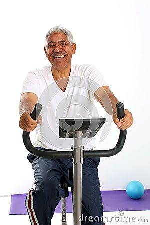Free Senior Man Riding Bike Stock Image - 6636401