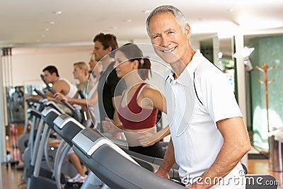 Senior Man On Running Machine