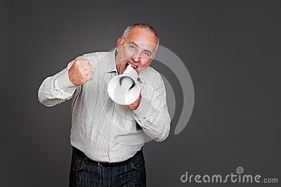 Senior man shouting with megaphone