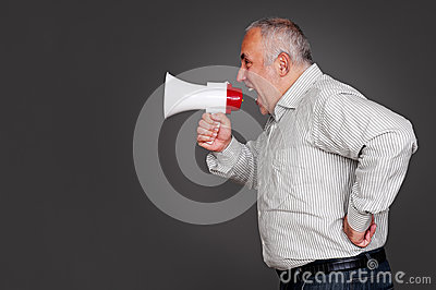 Senior man shouting through the megaphone