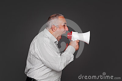 Senior man shouting using megaphone