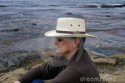 Senior Man Sitting Alone Thinking or Meditating