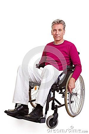 Free Senior Man Sitting In Wheelchair Stock Image - 18406571