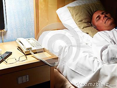 Senior man sleeping peacefully in bed