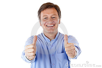 Senior man smiles happy and shows both thumbs up
