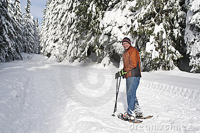 Senior man snowshoeing
