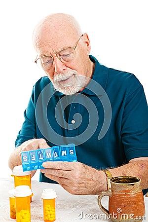 Free Senior Man Sorting Pills Royalty Free Stock Photo - 23178975