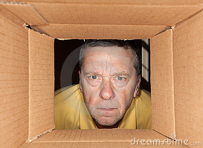 Senior man staring into cardboard box