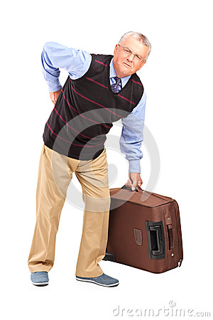 Senior man suffering from a back pain