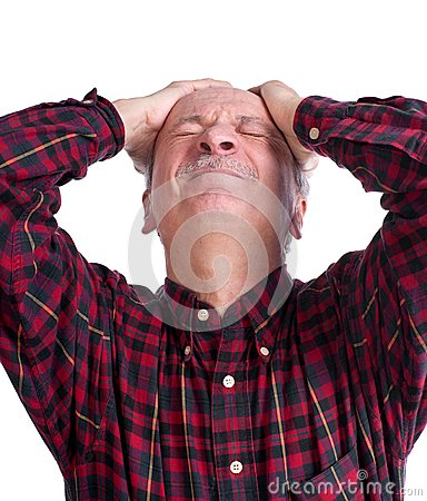 Senior man suffering from a headache