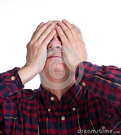 Senior man suffering from a headache
