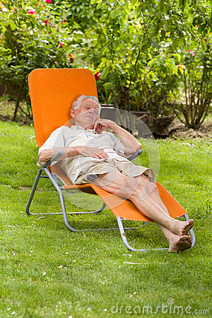 Senior man in sunbed