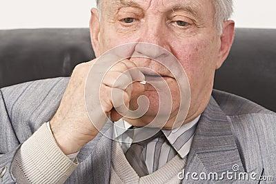 Senior man taking medication