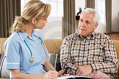 Senior Man Talking To Health Visitor