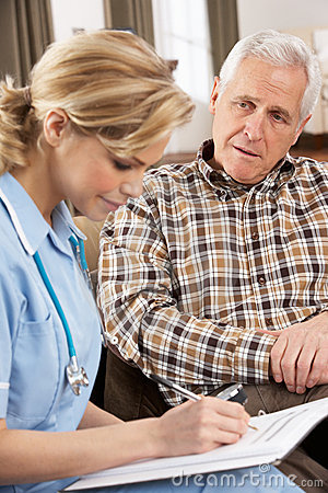 Senior Man Talking To Health Visitor